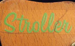 Decal of the Stroller model name, in the green scripted font of the early 1960s