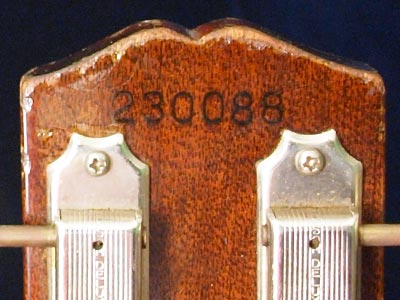 The serial number stamped onto the reverse of this headstock dates this guitar as a 1964 instrument