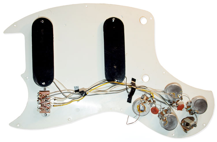 Under the scratchplate: the wiring loom of a Kalamazoo KG2 guitar