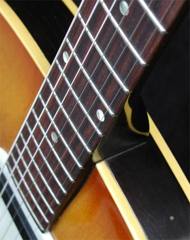 20 fret rosewood fretboard, with dot position markers. The neck joined the body at the 14th fret