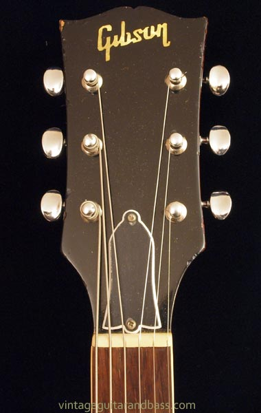 The headstock front has a pearl inlaid Gibson logo - without a dotted i