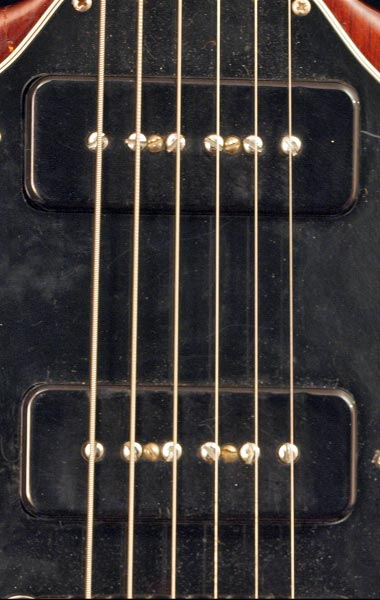 The twin P90 soapbar pickups are mounted with two screws going through the pickup (between the 2nd and 3rd and 4th and 5th polepieces)