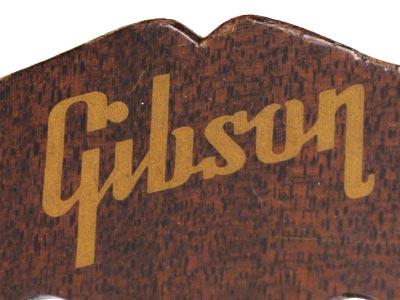 The Gibson logo on a walnut-finished headstock