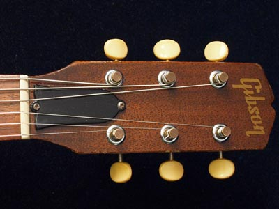 Slim Gibson Melody Maker headstock with walnut finish