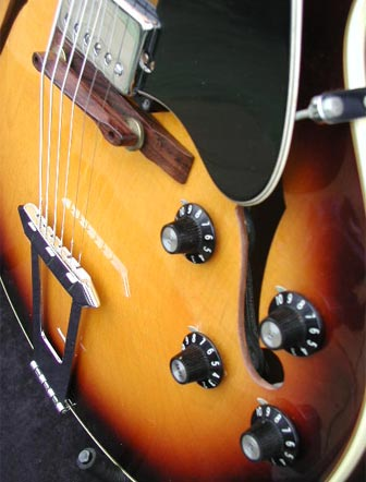 1974 Gibson ES-175D body detail: close up of Gibson witch-hat knobs