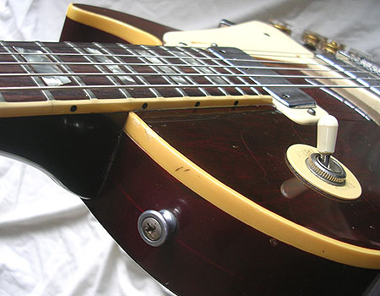 1976 Wine Red Les Paul Deluxe top side view showing strap button