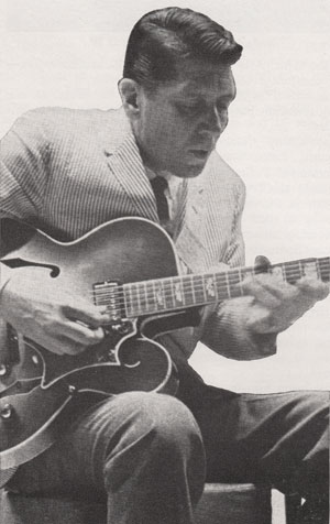 Tal Farlow demonstrating his new signature guitar for Gibson in July 1963 (Chicago NAMM show)