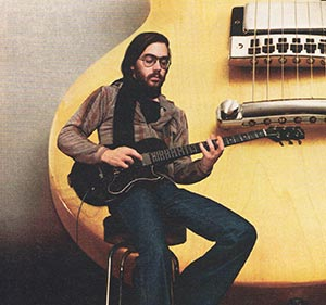 Al DiMeola in his 1977 Gibson advertisement for the L6-S Custom
