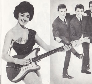 Carol Elvin poses with a Vox Consort guitar