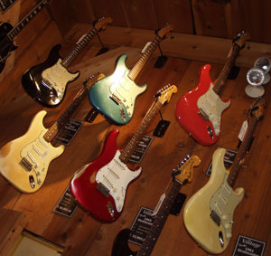 Early Fender stratocaster guitars on display in an upmarket US vintage guitar store