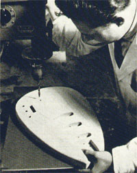 Vox prototype designer Mick Bennett drills holes for control knobs, of a Vox Mark guitar at the Dartford plant, United Kingdom