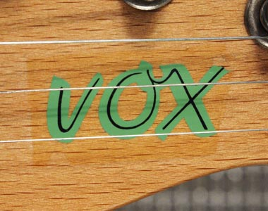 Vox decal on headstock